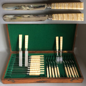 A set of silver plated dessert cutlery with Elephant tooth handles.