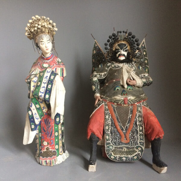 A pair of cold painted pottery figures. Characters from the Peking Opera. Chinese circa 1900